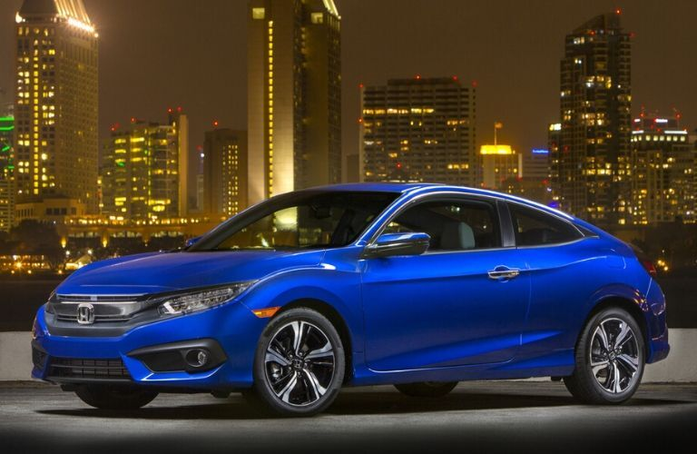 2018 Honda Civic with nighttime city skyline in the background