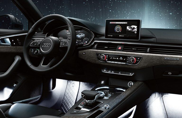 2019 Audi A4 front seating area with night sky outside