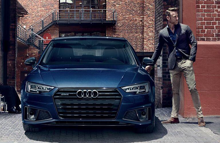 man walking up to 2019 Audi A4