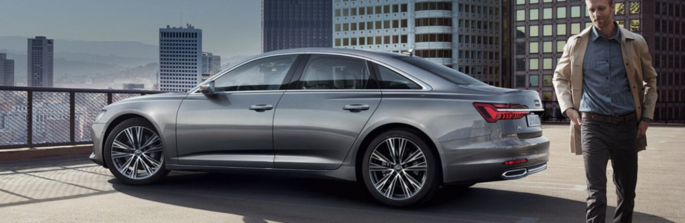 man walking away from parked 2019 Audi A6