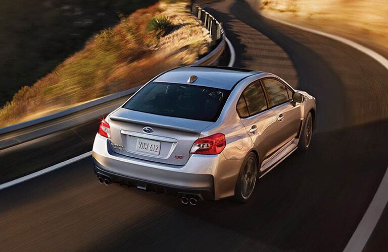 2019 Subaru WRX seen from the top rear rounding a curve