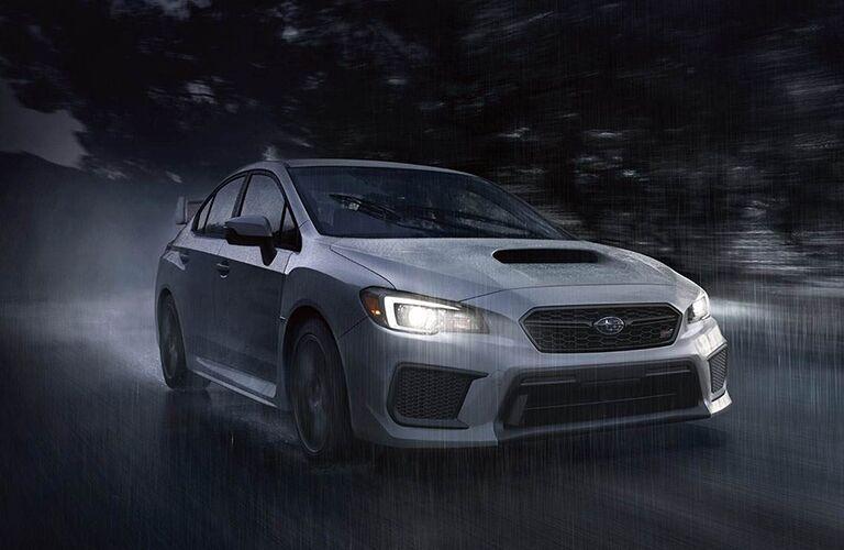 2019 Subaru WRX at night driving through rain