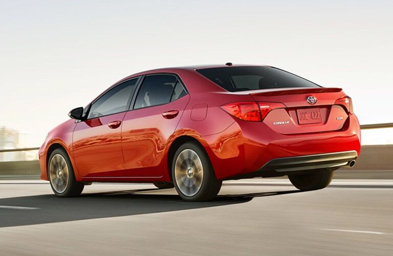 2019 Toyota Corolla exterior rear quarter view as it drives away on a highway road