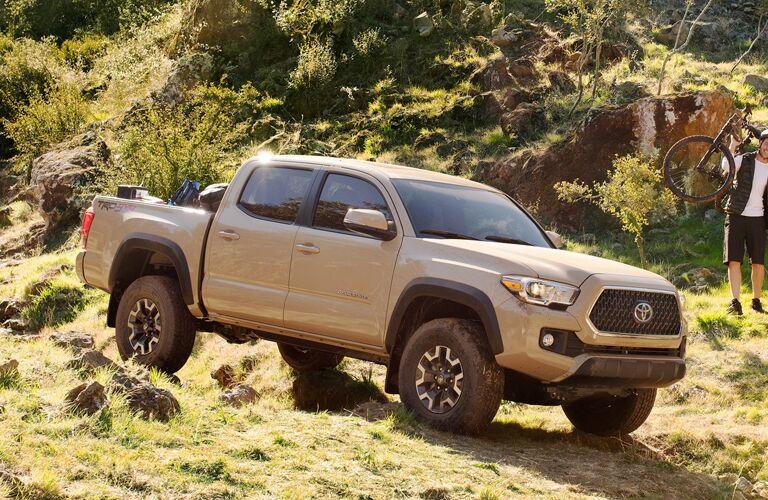 2019 Toyota Tacoma driving over rocky terrain