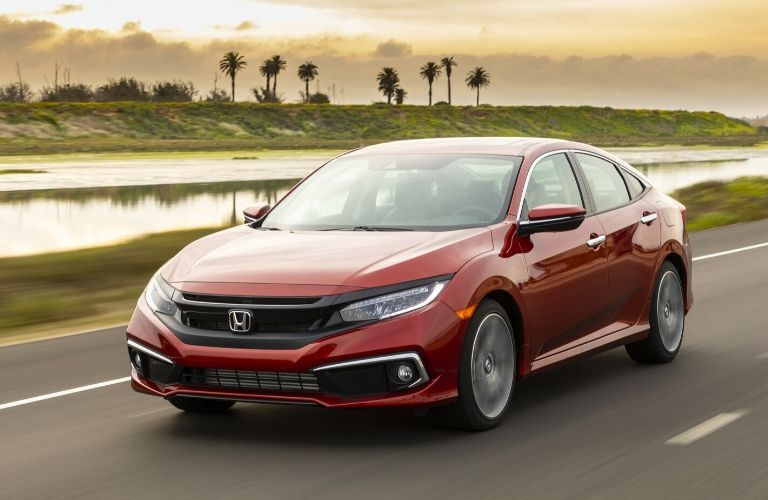 2019 Honda Civic driving near palm trees
