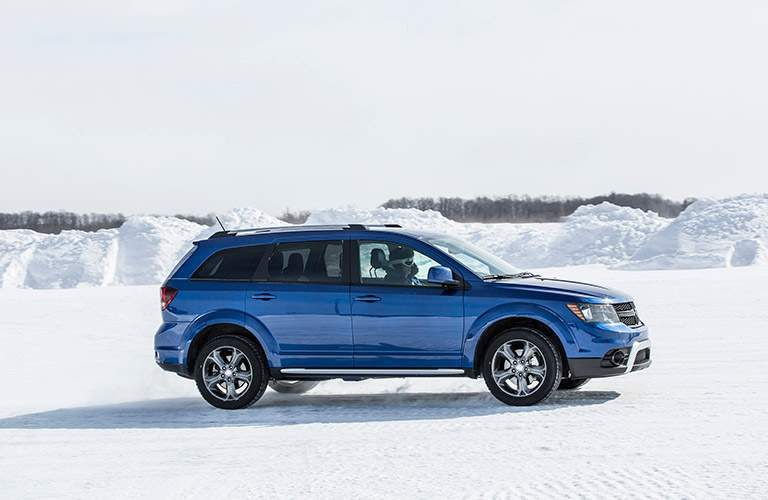 blue dodge journey in snow
