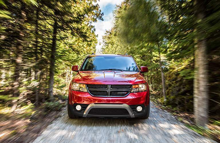 red dodge journey driving in woods