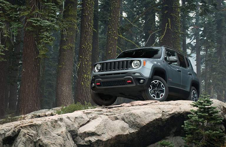 gray jeep renegade on rocks