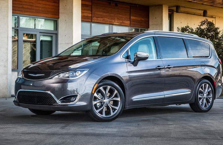 front and side view of silver 2018 chrysler pacifica in front of building