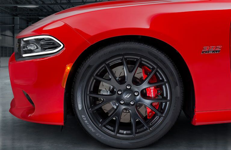 front wheel and tire of red 2018 dodge charger