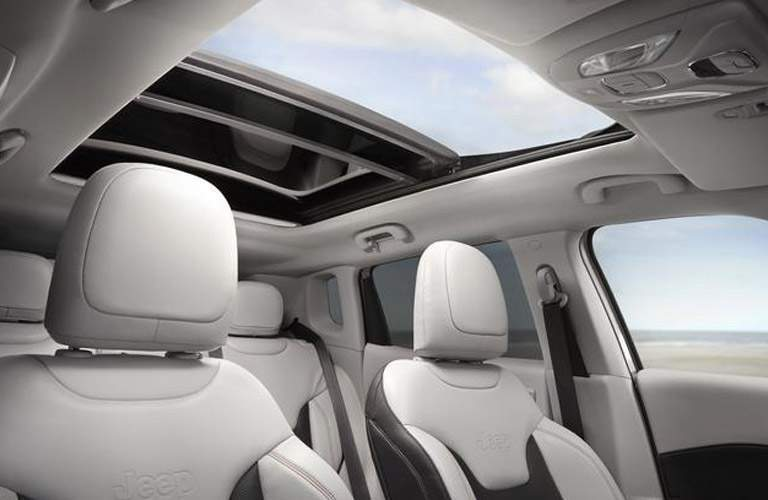 interior of 2018 jeep compass including seats and panoramic sunroof
