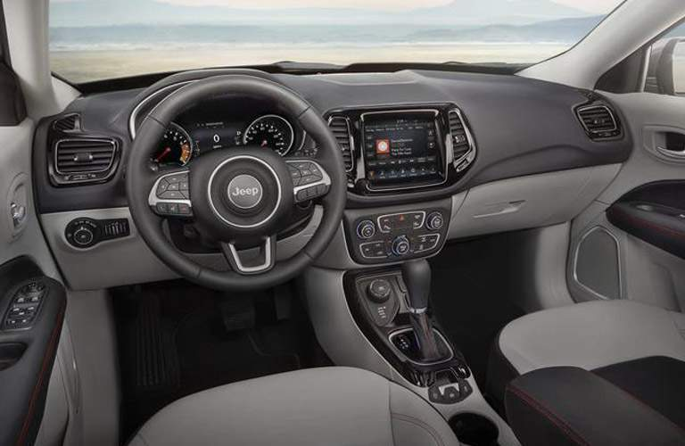 front interior of 2018 jeep compass including steering wheel, dashboard and center infotainment system
