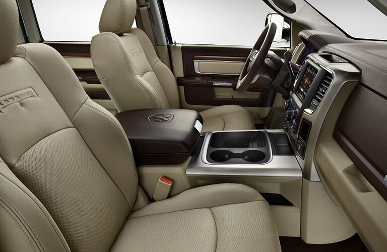 side view of front interior of 2018 ram 3500 including seats and center console