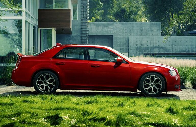 side view of red 2019 chrysler 300