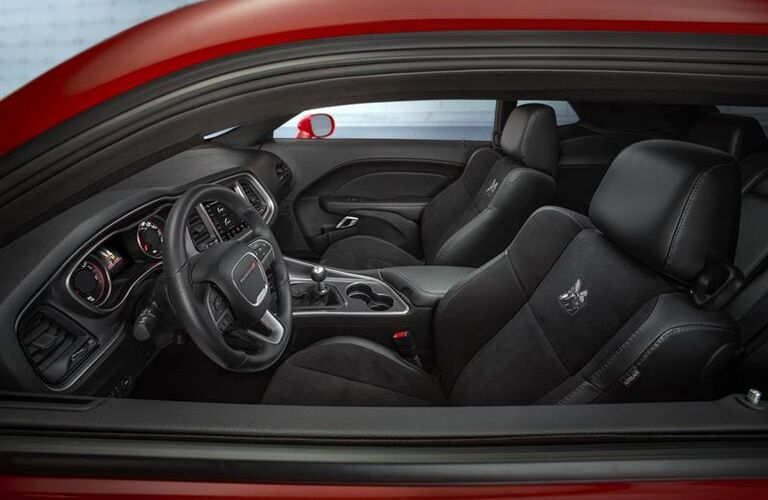 side view of front interior of 2019 dodge challenger including driver and passenger seats
