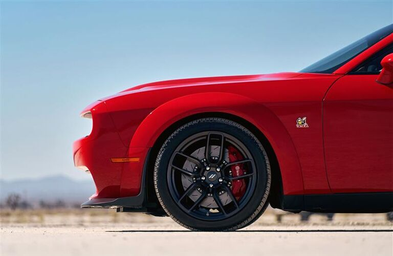side view of front end of red 2019 dodge challenger