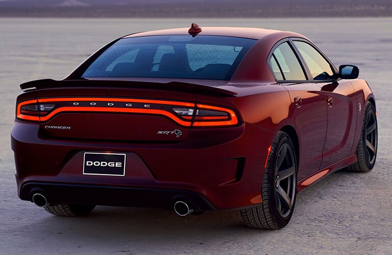 rear and side view of red 2019 dodge charger