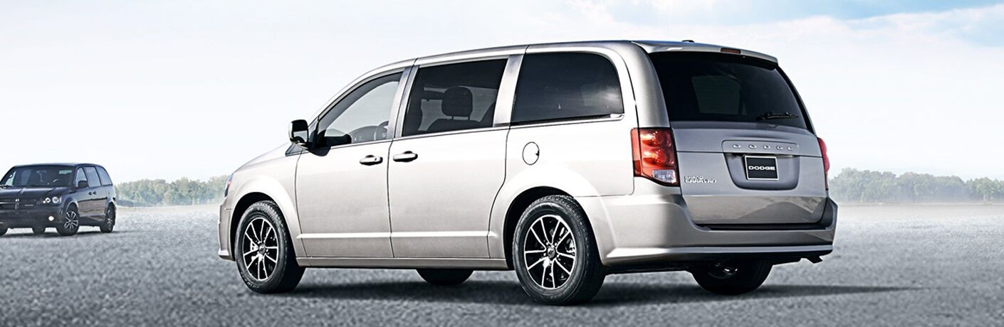 side and rear view of silver 2019 dodge grand caravan