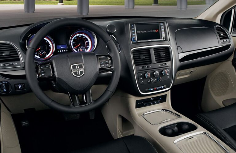 front interior of 2019 dodge grand caravan including steering wheel and infotainment system