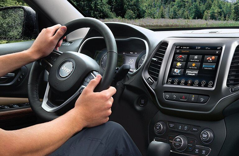 front interior of 2019 jeep cherokee including steering wheel and infotainment system