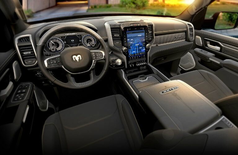 front interior of 2018 ram 1500 including steering wheel and infotainment system