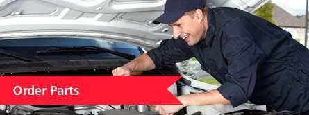 man working under hood of car