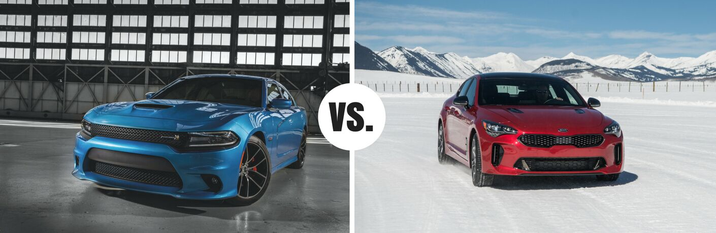 blue dodge charger in garage and red kia stinger in snow