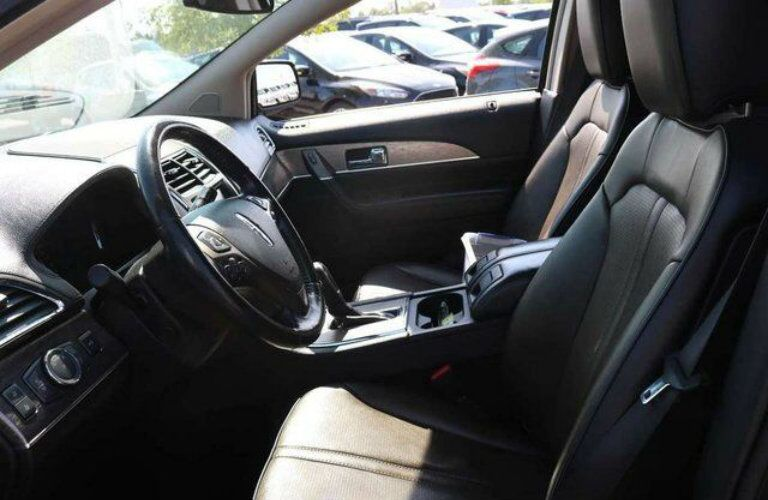 Interior view of a 2011 Lincoln MKX showing black seating and steering wheel