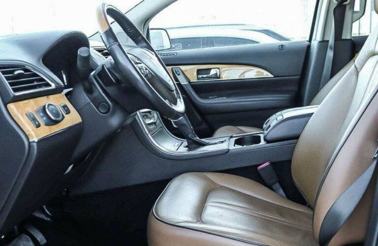 Interior view of a 2013 Lincoln MKX showing brown seating and steering wheel