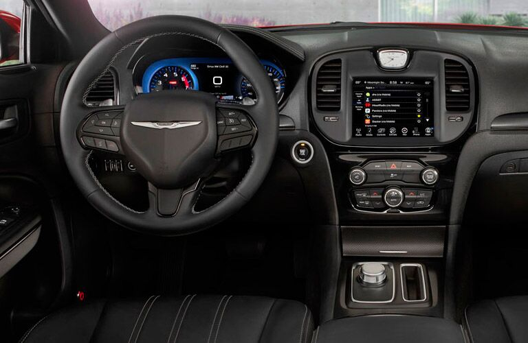 Interior view of the steering wheel and touch screen of a 2015 Chrysler 300
