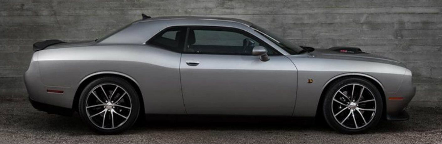 Exterior view of the passenger's side of a silver 2015 Dodge Challenger