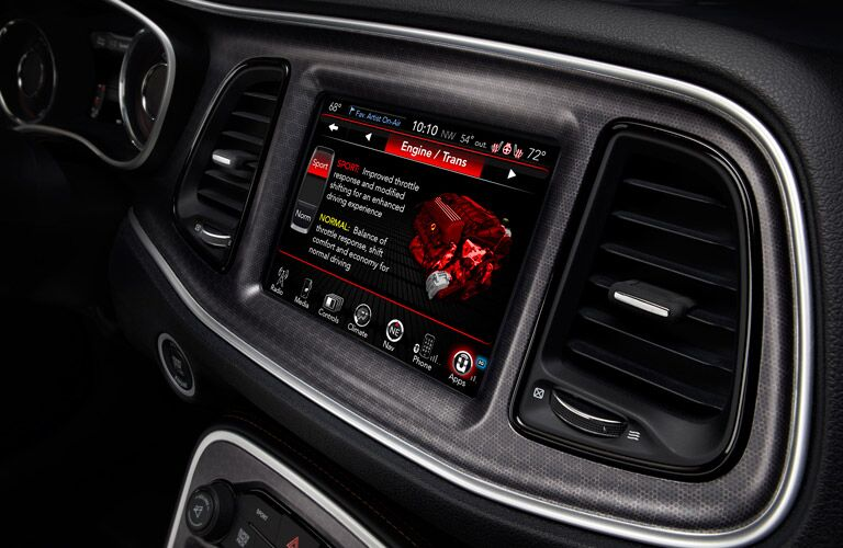 Interior view of the touchscreen infotainment system of a 2016 Dodge Challenger