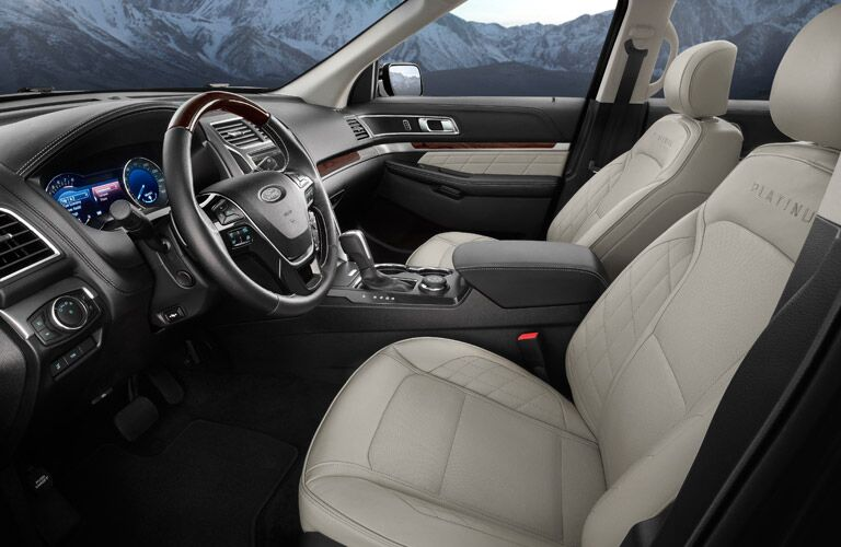 Interior view of the tan seating and black steering wheel inside a 2016 Ford Explorer