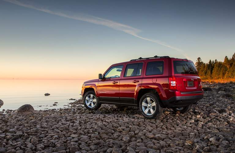 Red 2016 Jeep Patriot Parked by a Lake