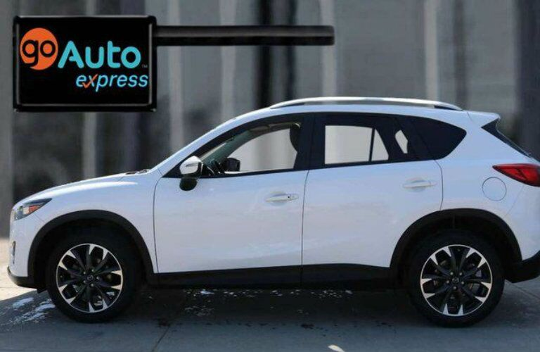 Exterior view of a white 2016 Mazda CX-5 parked in the Go Auto Express lot