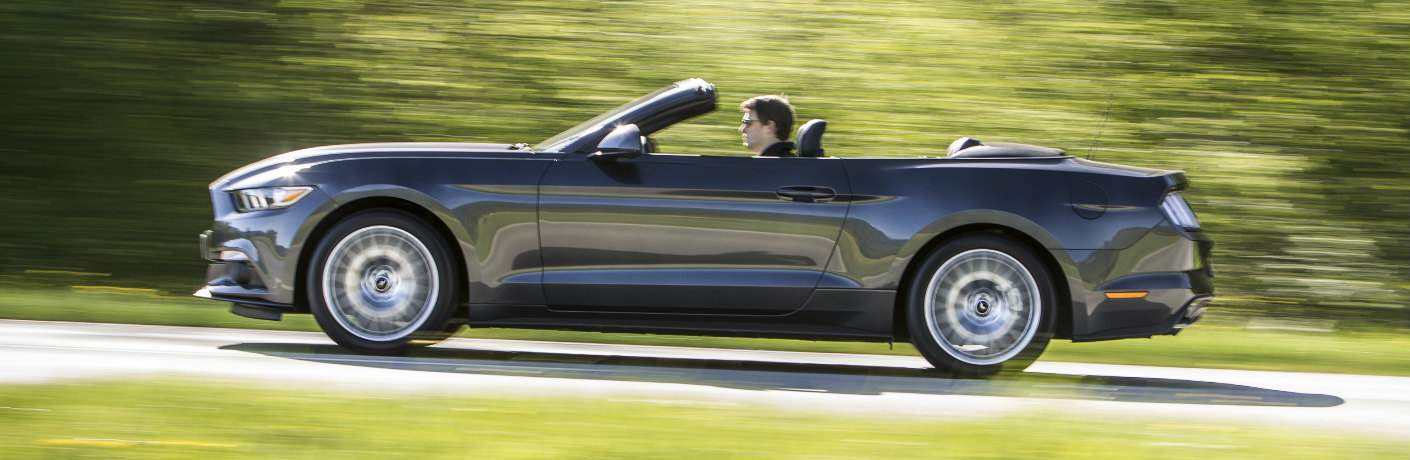 2016 Ford Mustang Convertible driving fast exterior driver side view