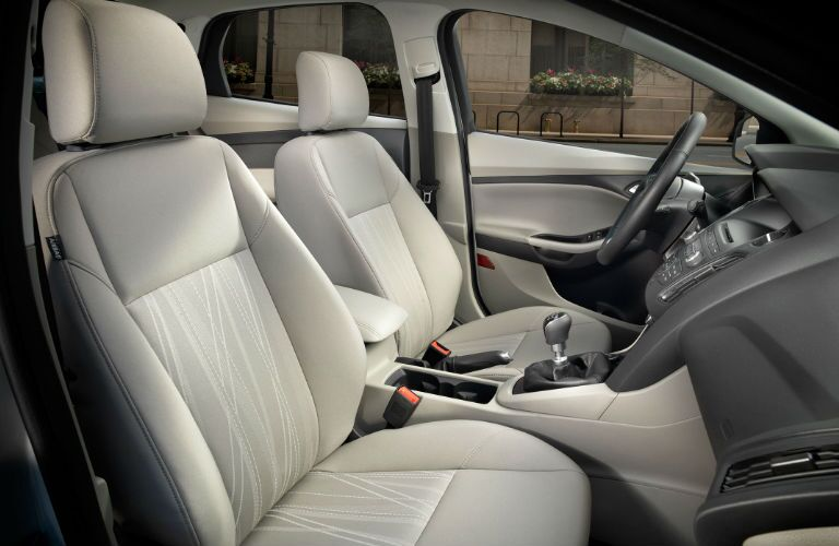Interior view of the beige front seats in a 2017 Ford Focus