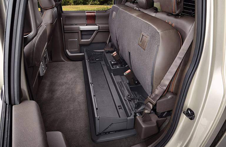 back seat area with seats folded up inside 2017 Ford Super Duty pickup