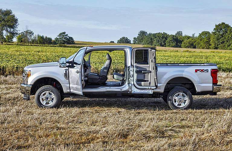 2017 Ford Super Duty pickup truck seen from driver's side with all doors open