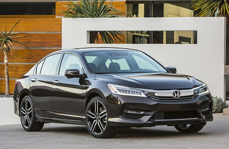 Exterior view of a black 2017 Honda Accord Parked in a driveway