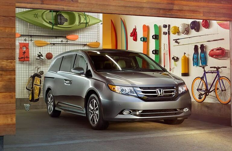 Exterior view of a silver 2017 Honda Odyssey parked in an open garage