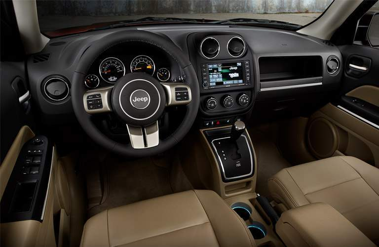 Dashboard and Tan Front Seats of 2017 Jeep Patriot