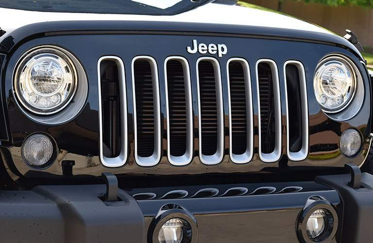Grille, Headlights, Fog Lights and Daytime Running Lights of Blue 2017 Jeep Wrangler
