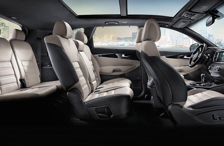 Interior view of the three rows of tan seating inside a 2017 Kia Sorento