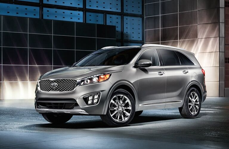 Exterior view of a grey 2017 Kia Sorento parked outside an office building