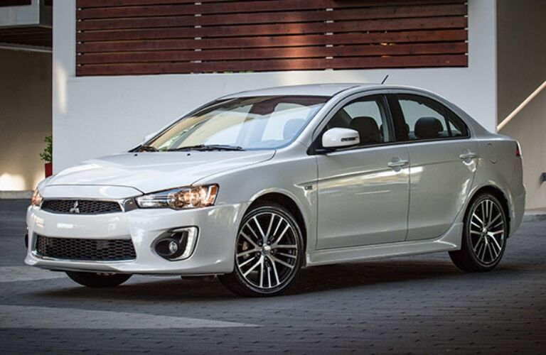 Exterior view of a white 2017 Mitsubishi Lancer parked in a driveway