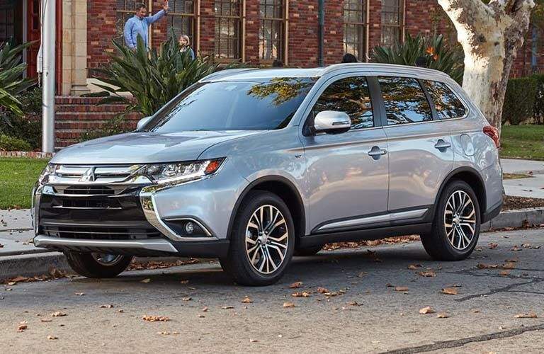 Exterior view of a silver 2017 Mitsubishi Outlander parked on a suburban street