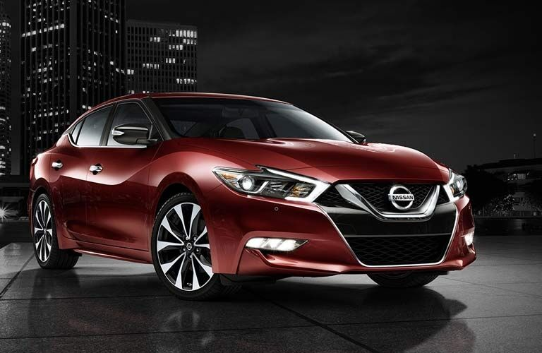 Exterior view of a red 2017 Nissan Maxima Parked on a city street