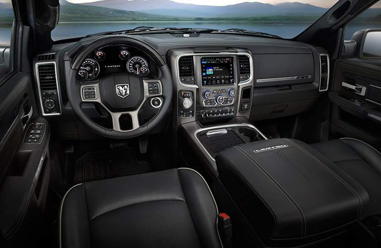 Interior view of the black seating and dashboard of a 2017 RAM 1500