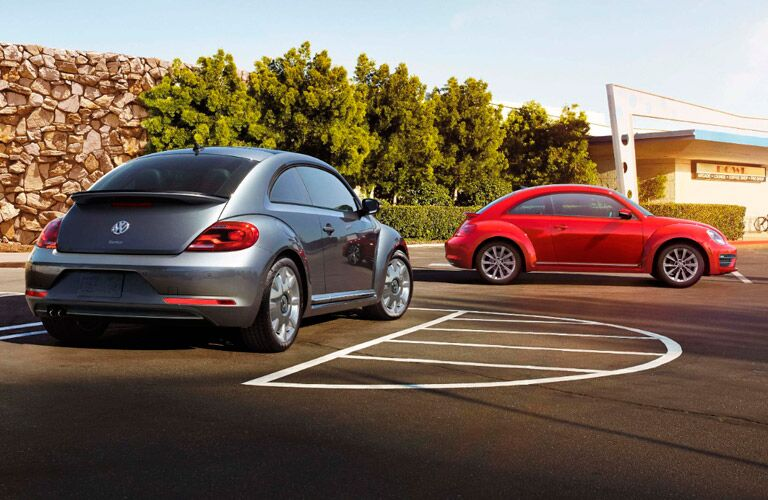 Exterior view of two 2017 Volkswagen Beetle models parked in an empty parking lot